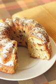 Baked gugelhupf with icing sugar — Stock Photo