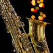 Vintage Saxophone on black  background. - Stock Photo