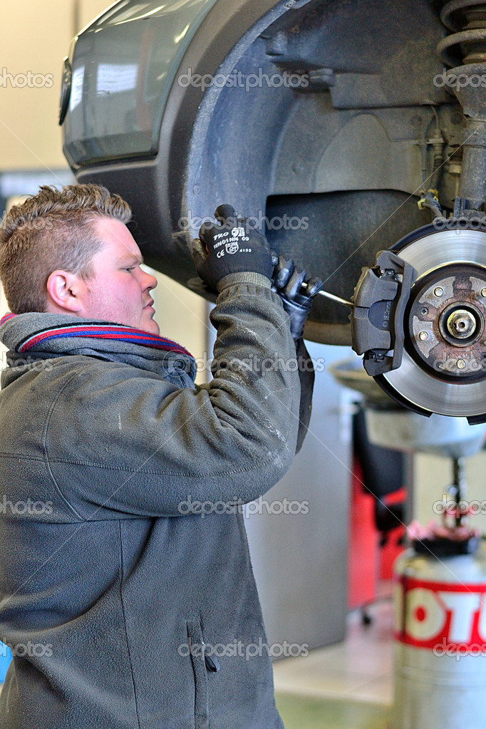 Mechanic working on a brake calliper — Stock Photo #18861211