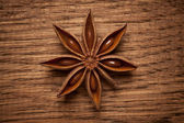 Aniseed on wooden background — Stock Photo