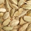 Cardamon seeds background - Stock Photo