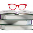 Red glasses on open book — Stock Photo #23531587