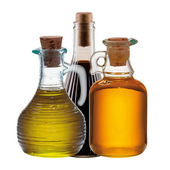 Three bottles of olive, oil and vinegar — Stock Photo