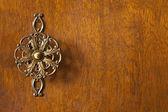 Detail of wardrobe door with decorative knob — Stock Photo