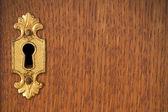 Keyhole on wooden background — Stock Photo