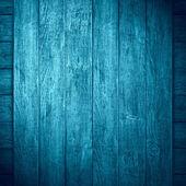 Niebieskim tle drewniane — Zdjęcie stockowe