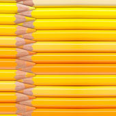 Yellow pencils background — Stock Photo