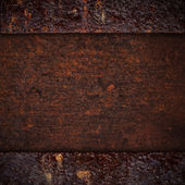 Brown rusty iron background or grainy rough pattern metal textur — ストック写真
