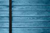 Wooden planks background with black metal bar — Stock Photo