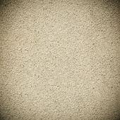 Sepia grainy plaster background — Stock Photo