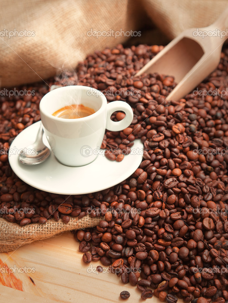 Coffee beans and cup of coffee — Stock Photo #12868924