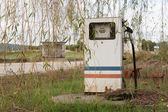 Old, rusty and abandoned gas pump against nature — Stock Photo