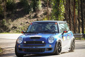 LEIRIA, PORTUGAL - FEBRUARY 2: Joao Goncalves drives a Mini Cooper S during 2013 Amateur Winter Rally, in Leiria, Portugal on February 2, 2013. — Stock Photo