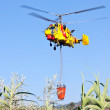 PENELA, PORTUGAL - AUGUST 28 : Fire rescue heavy helicopter, with water bucket, preparing for water scooping for combat a fire in Penela August 28, 2010 in Penela, PORTUGAL — Stock Photo