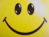 Background with a yellow smiley face — Stock Photo