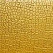 Gold alligator patterned background — Stock Photo
