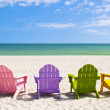Adirondack Beach Chairs on a Sun Beach in front of a Holiday Vac — Stock Photo #47725309