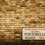 Portobello Road sign on a Brick Facade of a Building Architectur — Stock Photo #47727377