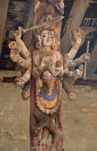 Nepal, Bhaktapur, Durbar square. Detail of the roof. Hindu temple decorated with wooden deity. — Stock Photo