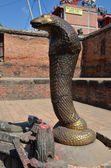 The serpent guards the reservoir in the Royal Palace on Durbar square in Bhaktapur — Stock Photo