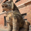 Nepal, Bhaktapur, Durbar square. Stone lion guards the entrance to the Royal Palace. — Stock Photo