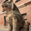 Nepal, Bhaktapur, Durbar square. Stone lion guards the entrance to the Royal Palace. — Stock Photo #17344789