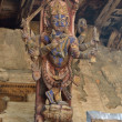 Nepal, Bhaktapur, Durbar square. Detail of roof. Hindu temple decorated with wooden deity. — Stock Photo #17345183