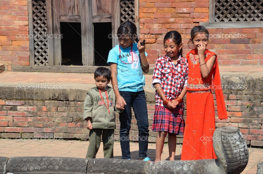 Nepalese children on Durbar square in Bhaktapur. — Stock Photo #17344487