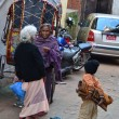 Stock Photo: Nepal, Kathmandu.Two elderly women talking on the street. Nearly is a boy.