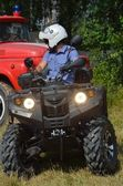Russian policeman on quad provides Public order. — Stock Photo