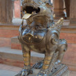 Stock Photo: Nepal, Bhaktapur, Durbar square. Lion near temple.