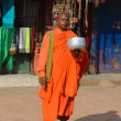 Stock Photo: Nepal. Monk gathers donations near Boudhanath stupin Kathmandu.