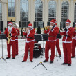 Stock Photo: Men's Orchestra, dressed like father frosts, is playing on street in Moscow