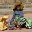 Stock Photo: Nepalese womsells food for pigeons in square in Patan