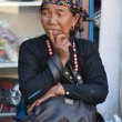 Stock Photo: Elderly Nepalese womin reverie.