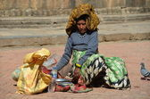 Nepalese woman sells food for pigeons in the square in Patan — Stock Photo