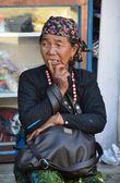 An elderly Nepalese woman in reverie. — Stock Photo