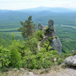 "Russia, Adygeya, mountain landscape in the spring. Rock of ""Devil's finger"",  Ridge Una-Koz. - Stock Photo"