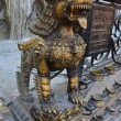 Nepal, Kathmandu, a mythical beast in the Buddhist temple complex of Swayambhunath — Stock Photo