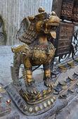 Nepal, Kathmandu, a mythical beast in the Buddhist temple complex of Swayambhunath — Stock Photo