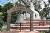 Nepal, Kathmandu, ritual bell and one of the small Stupas on the Svoyambu hill — Stock Photo