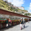 Tibetans commit the bark around the Potala Palace in Lhasa — Stock Photo