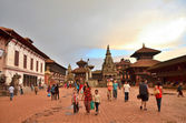 Nepal  Scene: Tourists walking on ancient Durbar square in Bhaktapur — Stock Photo