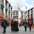 Tibet, buddists committing bark on ancient Barkhor Street surrounding the Jokhang in Lhasa — Stock Photo