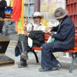 Tibet, Lhasa, two elderly men sitting on a bench near the Temple  Djokang — Stock Photo