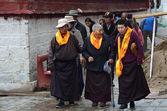Tibet, three elderly women committing bark on ancient Barkhor Street surrounding the Jokhang in Lhasa — Stock Photo