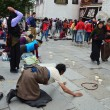 Tibet, Lhasa, Buddhists make prostration (pray) before the first Buddhist temple in Tibet, the Jokhang — Foto de Stock