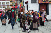 Tibet, Lhasa, people commit bark on ancient Barkhor street surrounding the Jokhang — Stock Photo
