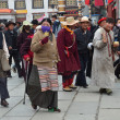 Stock Photo: Tibet, Lhasa, people commit bark on ancient Barkhor street surrounding Jokhang
