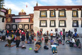 Tibet, Lhasa, Buddhists make prostration (pray) before the first Buddhist temple in Tibet, the Jokhang — Stock Photo